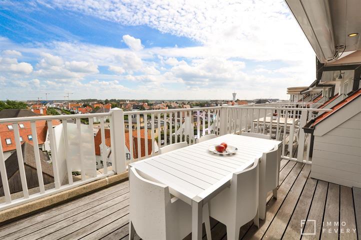 Hedendaags duplex-appartement met zonnig terras en open zicht!