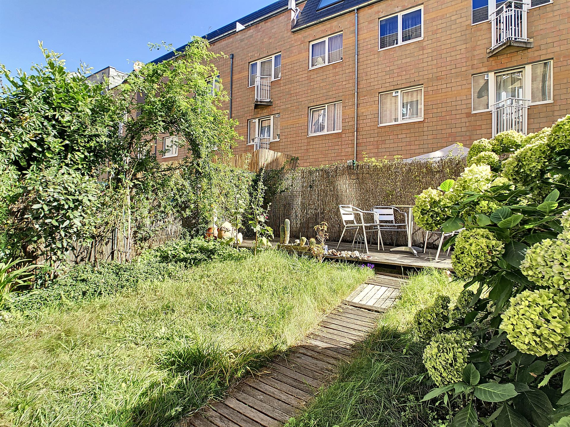 Rez-de-ch. avec jardin - Anderlecht - #4106650-1